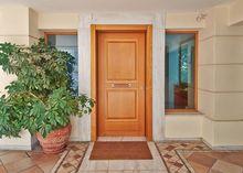 Drewniane drzwi wejściowe